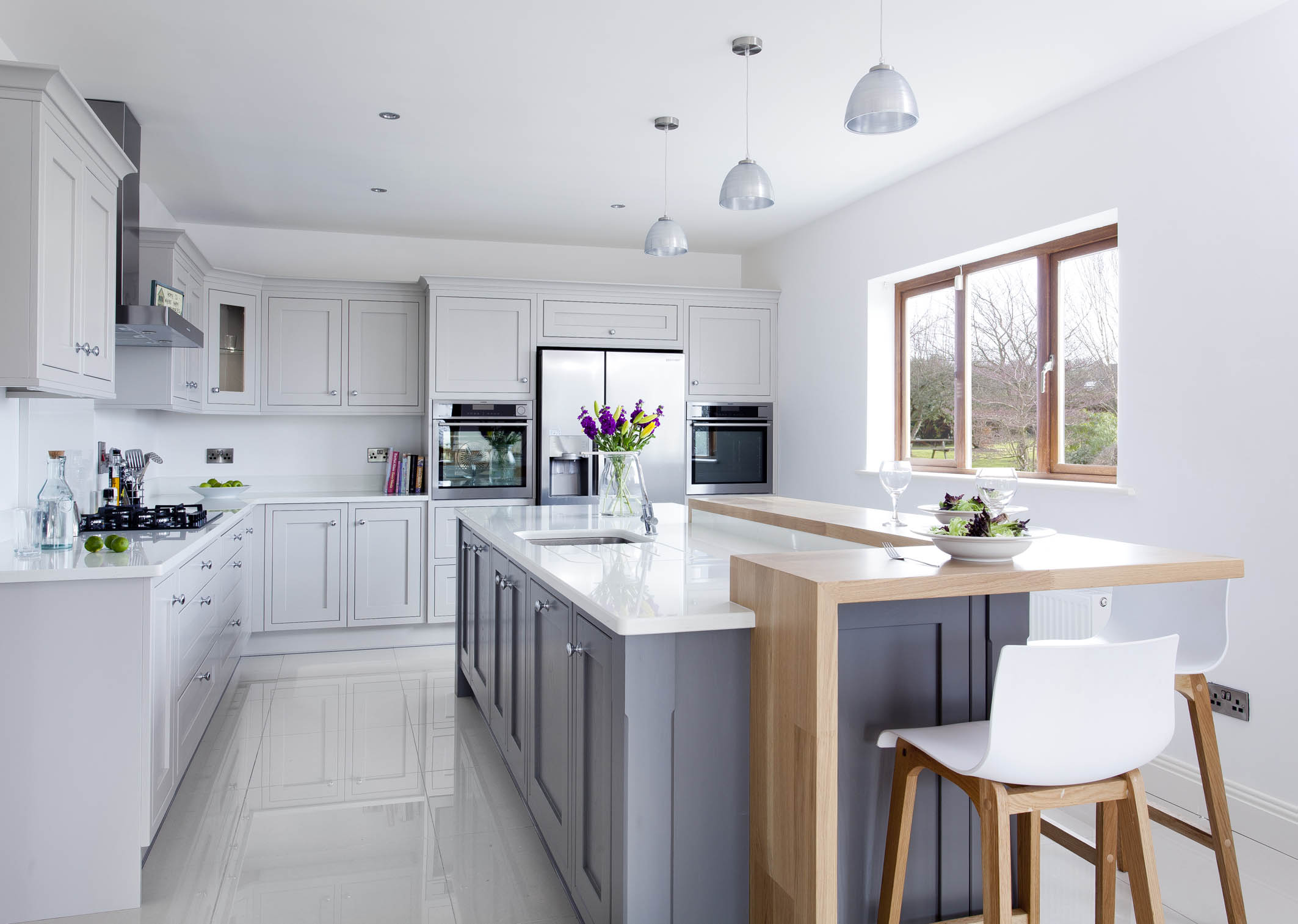 Contemporary classic painted kitchen, with oak breakfast